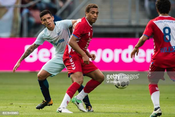Matias Kranevitter of FK Zenit St Petersburg Cyriel Dessers of FC Utrecht during the UEFA Europa League fourth round qualifying first leg match...