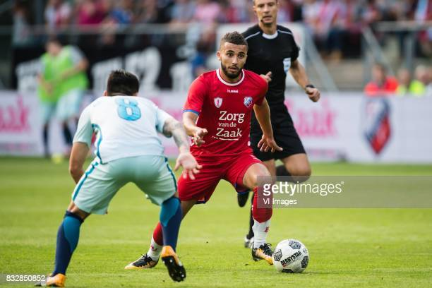 Matias Kranevitter of FK Zenit St Petersburg Zakaria Labyad of FC Utrecht during the UEFA Europa League fourth round qualifying first leg match...