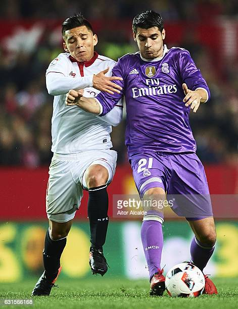 Matias Kranevitter of Sevilla FC competes for the ball with Alvaro Morata of Real Madrid CF during the Copa del Rey Round of 16 Second Leg match...