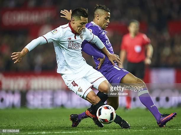 Matias Kranevitter of Sevilla FC competes for the ball with Mariano Diaz of Real Madrid CF during the Copa del Rey Round of 16 Second Leg match...