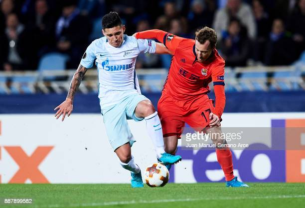 Matias Kranevitter of Zenit St Petersburg duels for the ball with David Zurutuza of Real Sociedad during the UEFA Europa League group L football...