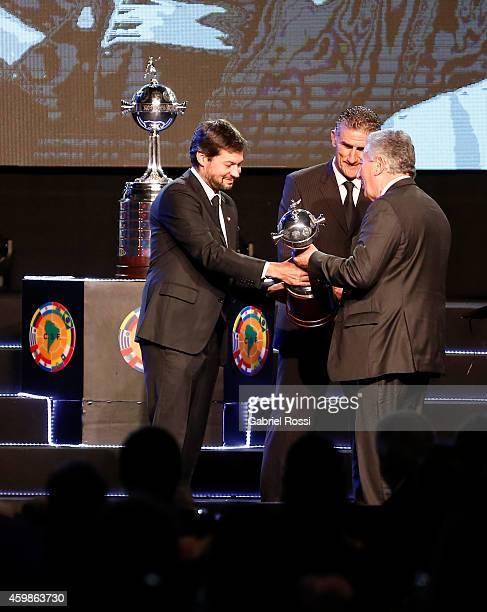 Matias Lammens President of San Lorenzo and Edgardo Bauza coach of San Lorenzo receive a replica of trophy from Luis Segura President of Argentina's...