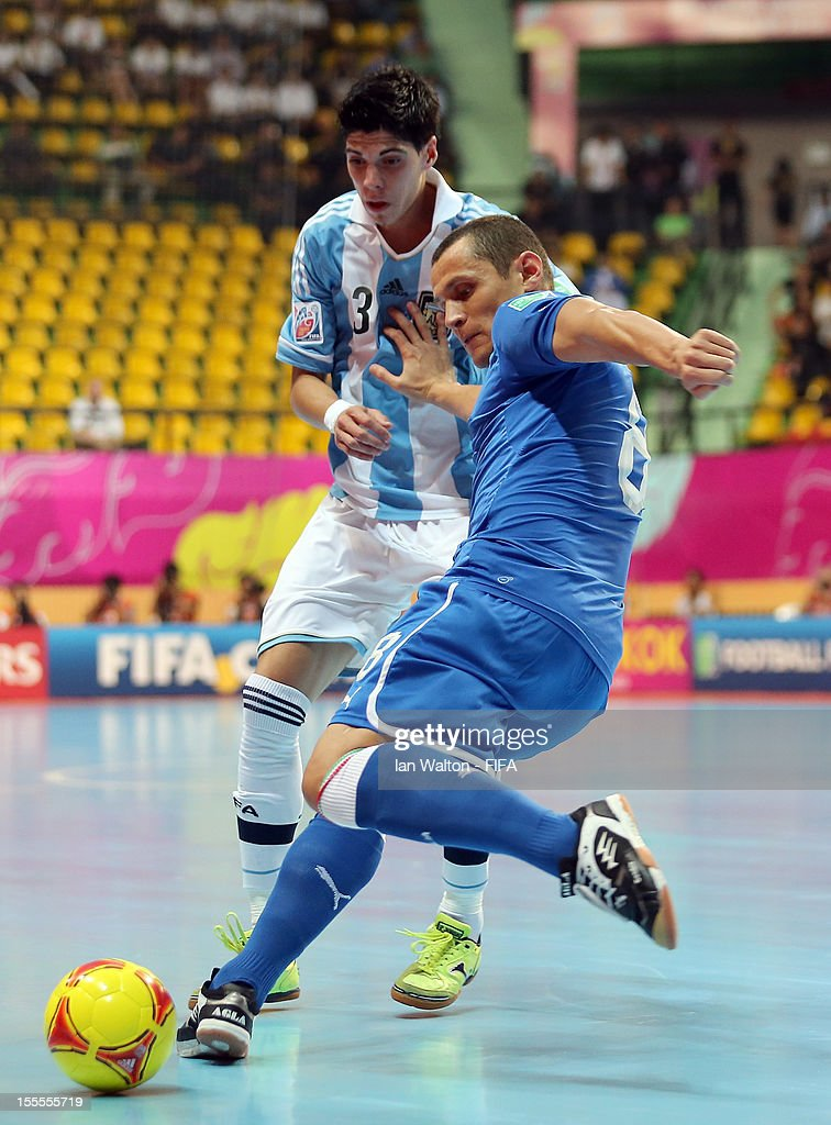 Matias Lucuix of Argentina tries to tackle Rodolfo Fortino of Italy during the FIFA Futsal World Cup Thailand 2012, Group D match between Argentina and Italy at Nimibutr Stadium on November 5, 2012 in Bangkok, Thailand.
