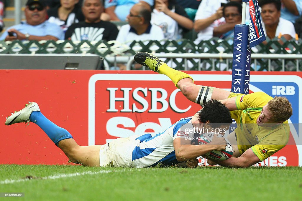 Matias Moroni of Argentina dives over to score a try during the match between Australia and Argentina on day two of the 2013 Hong Kong Sevens at Hong Kong Stadium on March 23, 2013 in So Kon Po, Hong Kong.