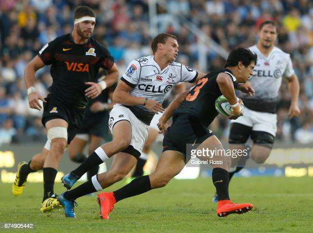 Matias Moroni of Jaguares evades a tackle from Curwin Bosch of Sharks during a match between Jaguares v Sharks as part of Super Rugby Rd 10 at Jose...