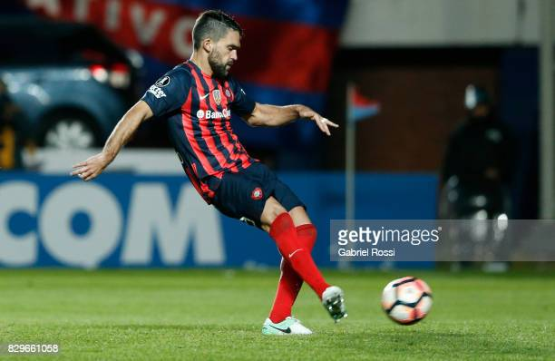 Matias Nicolas Caruzzo of San Lorenzo kicks during the penalty shootout after a second leg match between San Lorenzo and Emelec as part of round of...
