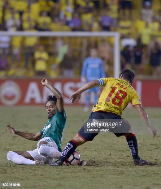 Matias Oyola of Barcelona fights for the ball with Ze Roberto of Palmeiras during a first leg match between Barcelona SC and Palmeiras as part of...