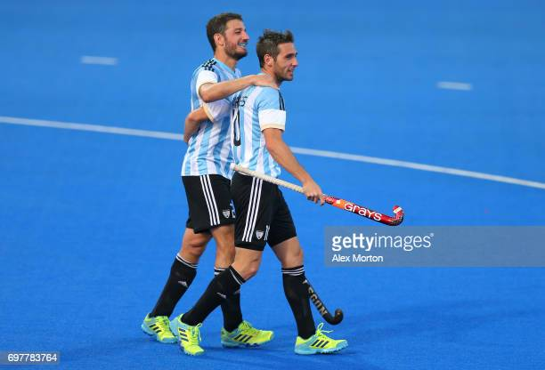 Matias Paredes of Argentina celebrates with teammates after scoring his team's fourth goal during the Pool A match between Argentina and China on day...