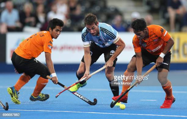 Matias Paredes of Argentina is held up by the Malaysia defence during the Pool A match between Argentina and Malaysia on day two of Hero Hockey at...