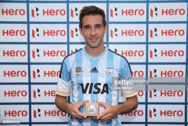 Matias Paredes of Argentina with his milestone award commemorating 300 caps for Argentina after the quarter final match between Argentina and...