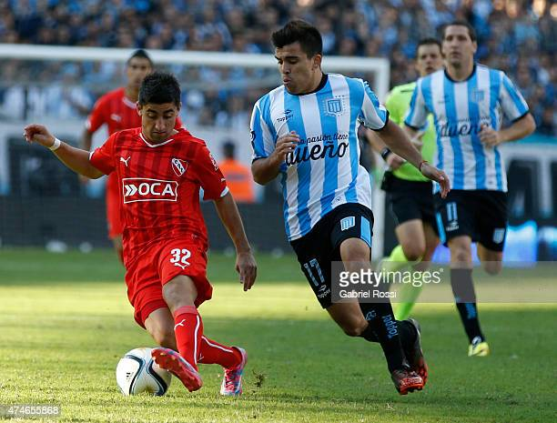 Matias Pisano of Independiente fights for the ball with Marcos Acuna of Racing Club during a match between Racing Club and Independiente as part of...