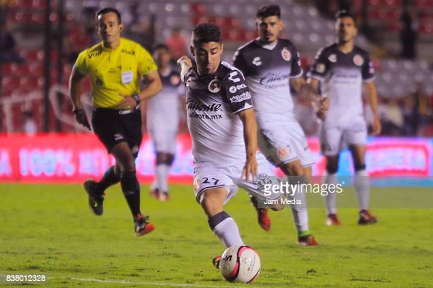 Matias Pisano of Tijuana kicks the ball during the 6th round match between Queretaro and Tijuana as part of the Torneo Apertura 2017 Liga MX at La...