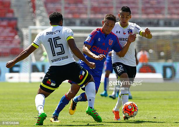 Matias Rodriguez of U de Chile fights for the ball with Jean Beausejour of Colo Colo during a match between U de Chile and Colo Colo as part of...