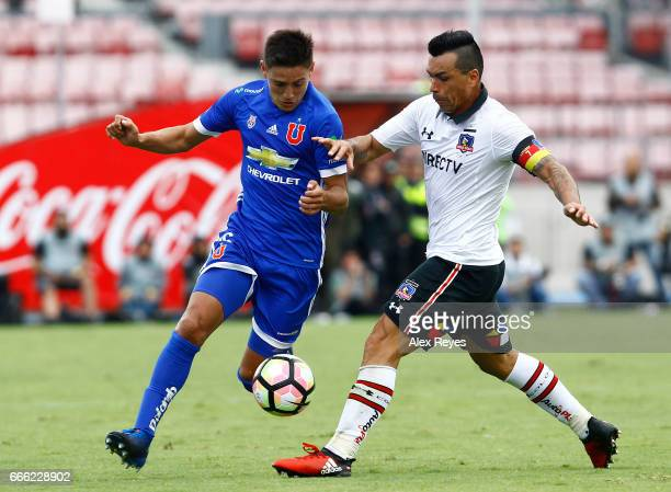 Matias Rodriguez of U De Chile struggles for the ball with Esteban Paredes of Colo Colo during a match between U de Chile and Colo Colo as part of...