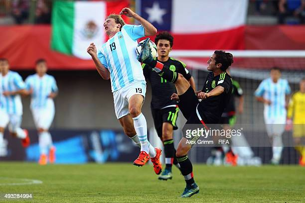 Matias Roskopf of Argentina is challenged by Diego Cortes of Mexico during the FIFA U17 World Cup Chile 2015 Group C match between Mexico and...