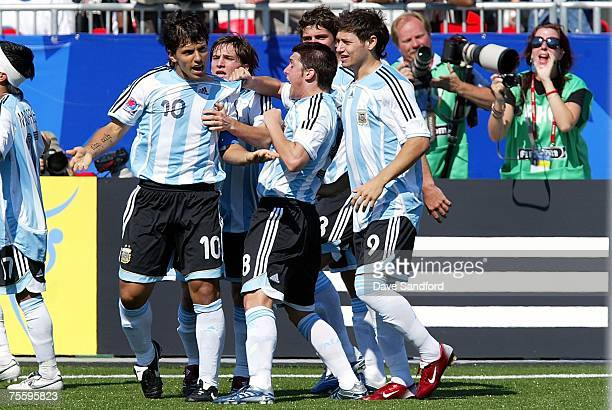 Matias Sanchez of Argentina and Mauro Zarate of Argentina celebrate with teammate Sergio Aguero who scored to tie the game against the Czech Republic...