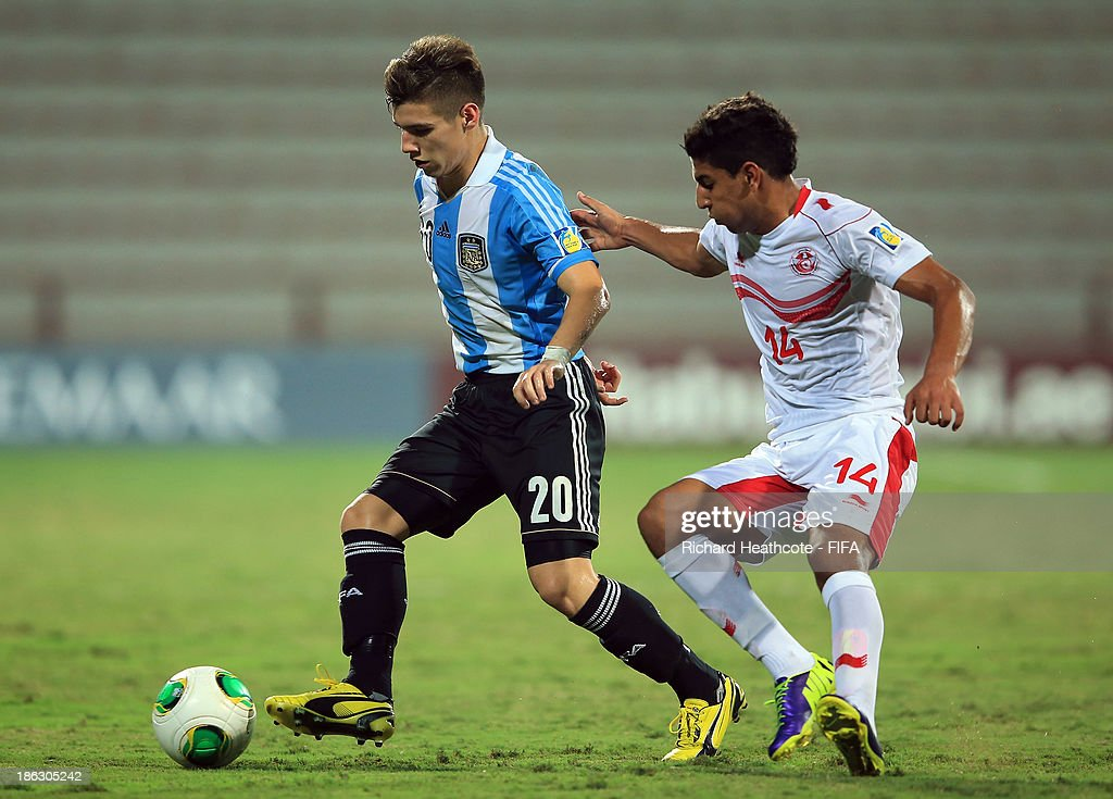 Matias Sanchez of Argentina holds off Nidhal Ben Salem of Tunisia during the FIFA U-17 World Cup UAE 2013 round of 16 match between Argentina and Tunisia at the Rashid Stadium on October 29, 2013 in Dubai, United Arab Emirates.