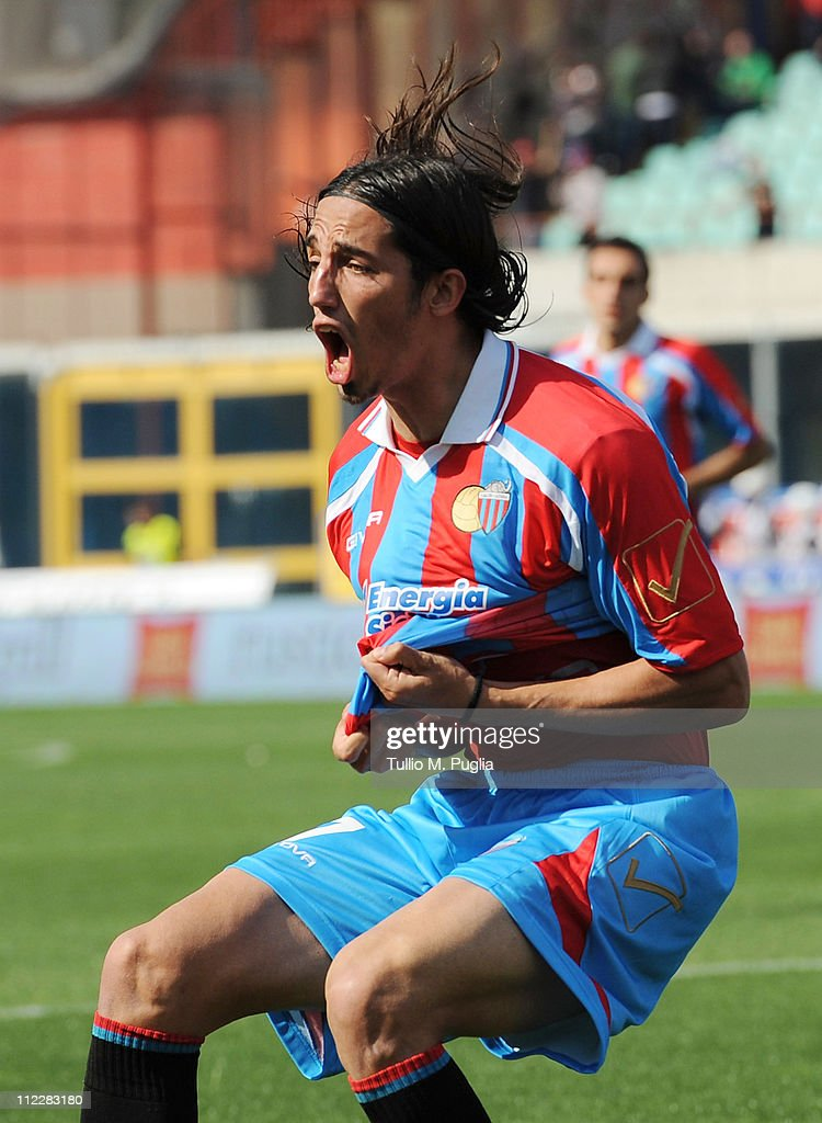 Matias Schelotto of Catania celebrates after scoring the equalizing goal during the Serie A match between Catania Calcio and SS Lazio at Stadio...