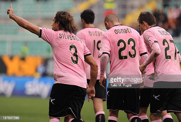 Matias Silvestre of Palermo celebrates with teammates after scoring his team's second goal during the Serie A match between US Citta di Palermo and...