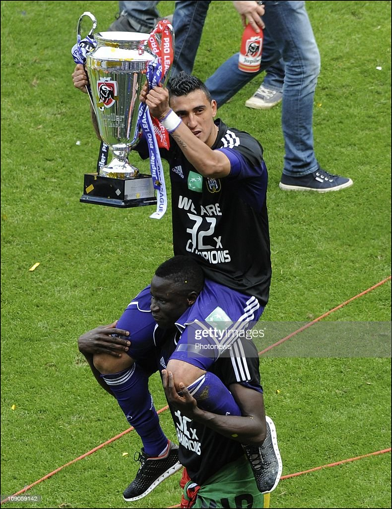 Matias Suarez of RSC Anderlecht and Cheikhou Kouyate of RSC Anderlecht celebrates winning the Jupiler League title 2012 - 2013 for the 32nd time in the history of the club on May 19, 2013 in Anderlecht, Belgium.