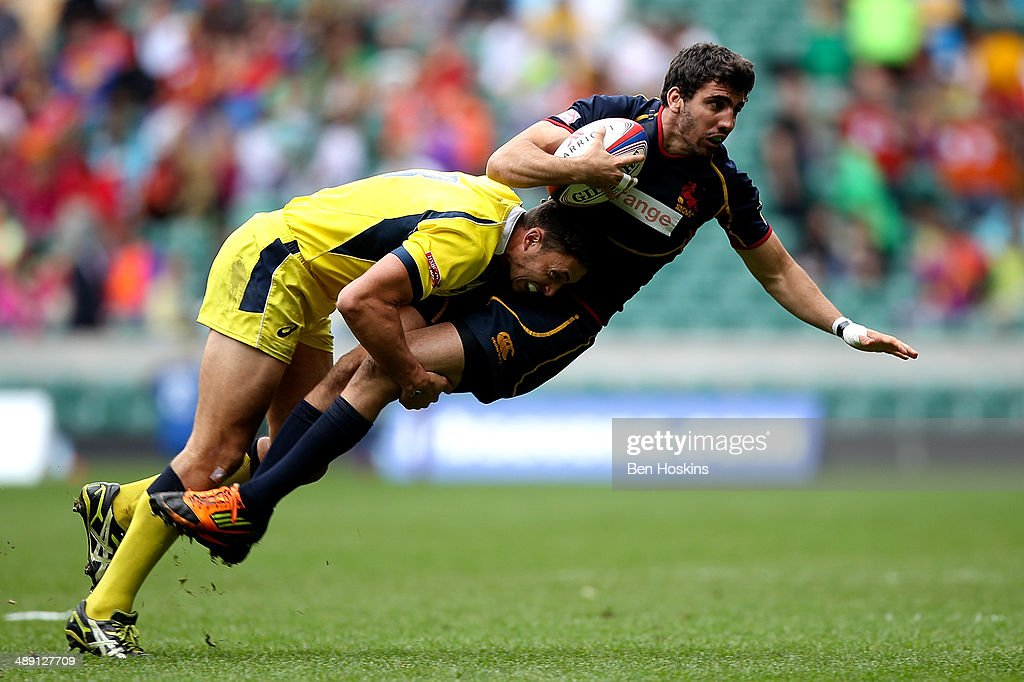 Matias Tudela of Spain is tackled by Peter Schuster of Australia during the Marriot London Sevens match between Australia and Spain at Twickenham Stadium on May 10, 2014 in London, England.