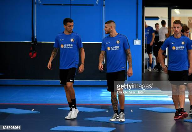 Matias Vecino and Mauro Icardi of FC Internazionale chat during a training session at Suning Training Center at Appiano Gentile on August 2 2017 in...