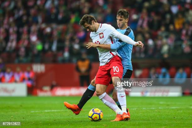 Matias Vecino Grzegorz Krychowiak in action during the international friendly match between Poland and Uruguay at National Stadium on November 10...