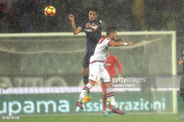 Matias Vecino of ACF Fiorentina battles for the ball with Diego Falcinelli of FC Crotone during the Serie A match between ACF Fiorentina and FC...