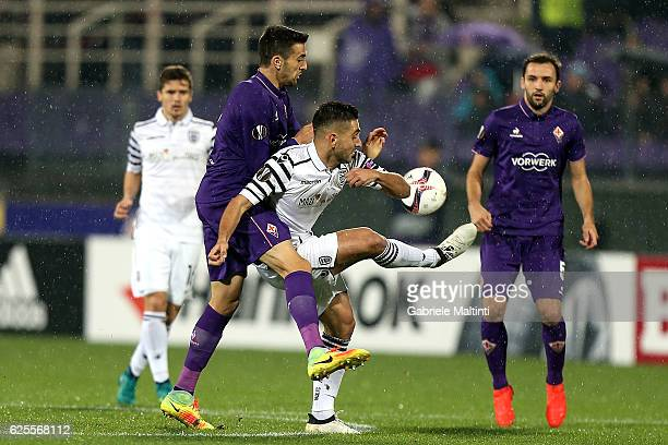 Matias Vecino of ACF Fiorentina battles for the ball with Efthymis Koulouris of PAOK FC during the UEFA Europa League match between ACF Fiorentina...
