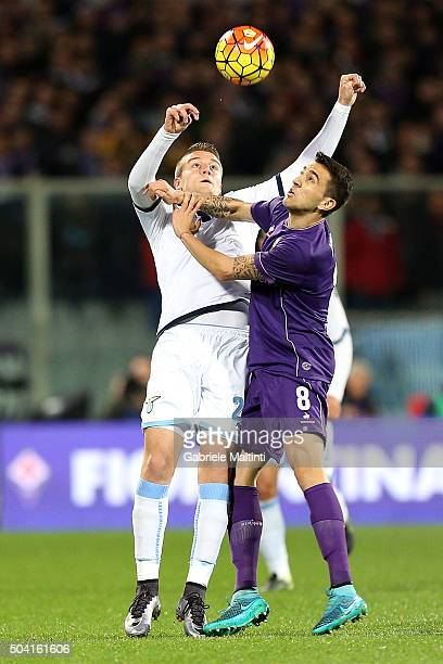 Matias Vecino of ACF Fiorentina battles for the ball with Sergej MilinkovicSavic of SS Lazio during the Serie A match between ACF Fiorentina and SS...