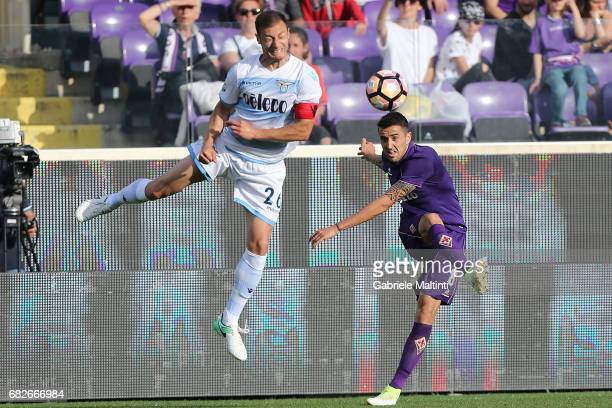 Matias Vecino of ACF Fiorentina battles for the ball with Stefan Radu of SS Lazio during the Serie A match between ACF Fiorentina and SS Lazio at...