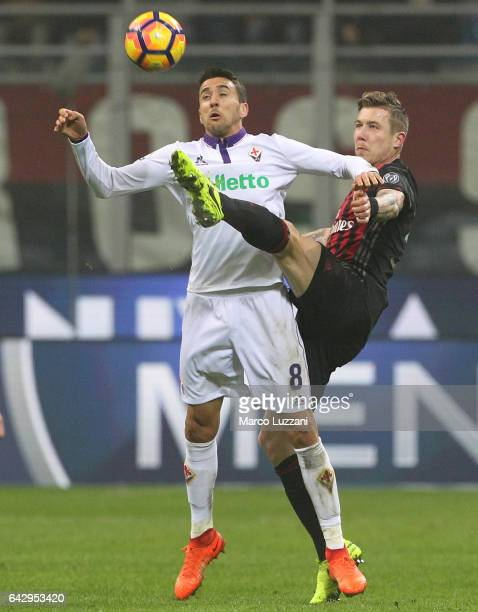 Matias Vecino of ACF Fiorentina competes for the ball with Juraj Kucka of AC Milan during the Serie A match between AC Milan and ACF Fiorentina at...