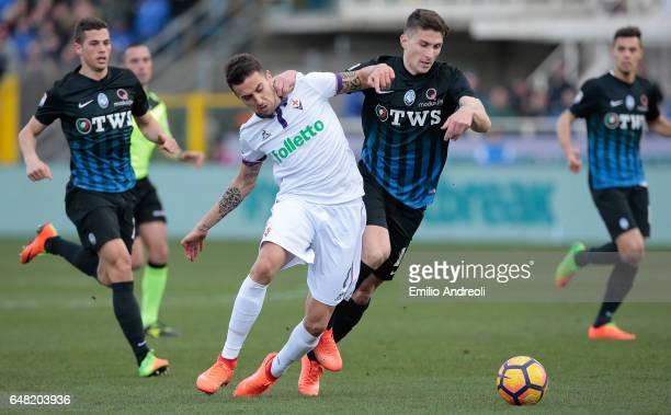 Matias Vecino of ACF Fiorentina competes for the ball with Mattia Caldara of Atalanta BC during the Serie A match between Atalanta BC and ACF...