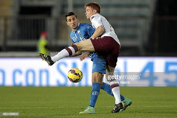 Matias Vecino of Empoli FC battles for the ball with Alessandro Gazzi of Torino FC during the Serie A match between Empoli FC and Torino FC at Stadio...