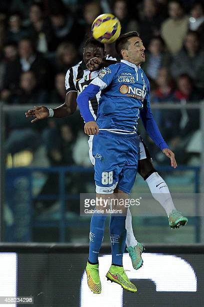 Matias Vecino of Empoli FC battles for the ball with Kwadwo Asamoah of Juventus FC during the Serie A match between Empoli FC and Juventus FC at...