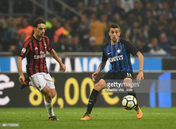 Matias Vecino of FC Internazionale competes for the ball with Giacomo Bonaventura of AC Milan during the Serie A match between FC Internazionale and...