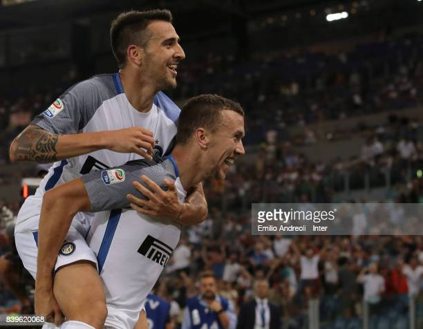 Matias Vecino of FC Internazionale Milano celebrates his goal with his teammate Ivan Perisic during the Serie A match between AS Roma and FC...