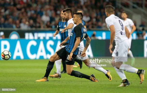 Matias Vecino of FC Internazionale Milano competes for the ball with Marco Benassi of ACF Fiorentina during the Serie A match between FC...