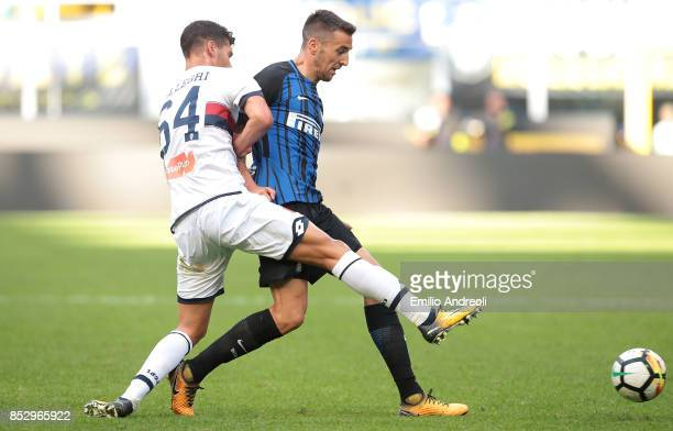Matias Vecino of FC Internazionale Milano competes for the ball with Pietro Pellegri of Genoa CFC during the Serie A match between FC Internazionale...