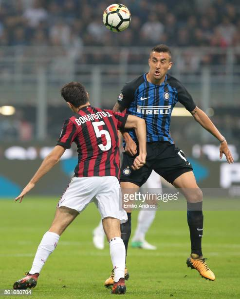 Matias Vecino of FC Internazionale Milano competes for the ball with Giacomo Bonaventura of AC Milan during the Serie A match between FC...