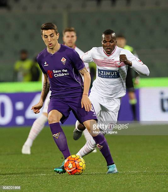 Matias Vecino of Fiorentina competes for the ball with Isaac Cofie of Carpi during the Serie A match between ACF Fiorentina and Carpi FC at Stadio...