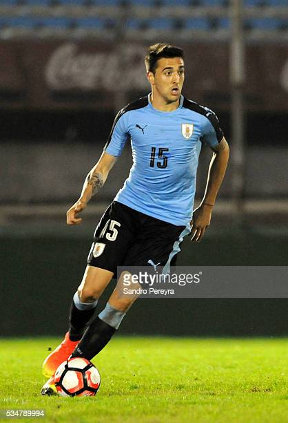 Matias Vecino of Uruguay drives the ball during an international friendly match between Uruguay and Trinidad Tobago at Centenario Stadium on May 27...