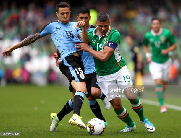 Matias Vecino of Uruguay tackles Jonathan Walters of the Republic of Ireland during the International Friendly match between Republic of Ireland and...