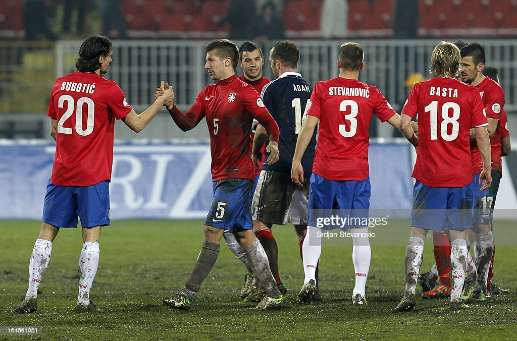 Matija Nastasic (2nd L) and Neven Subotic (L) of Serbia celebrate victory against Scotland after the FIFA 2014 World Cup Qualifier between Serbia and Scotland at Karadjordje Stadium on March 26, 2013 in Novi Sad, Serbia.