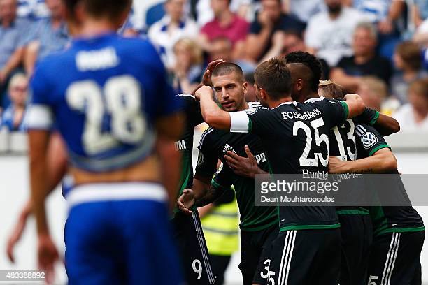 Matija Nastasic of FC Schalke 04 celebrates scoring his teams second goal of the game with team mates during the DFB Cup match between MSV Duisburg...