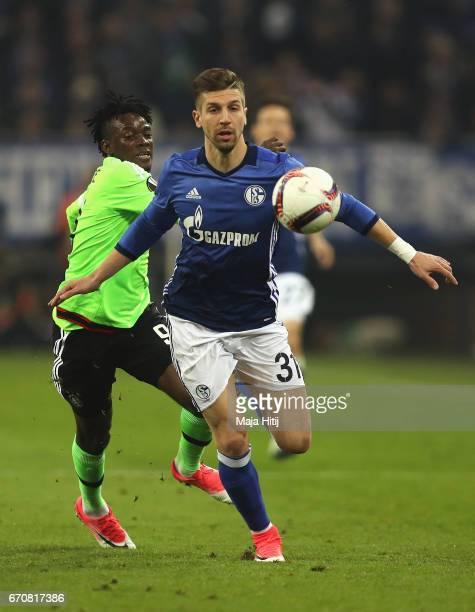 Matija Nastasic of FC Schalke 04 evades Bertrand Traore of Ajax during the UEFA Europa League quarter final second leg match between FC Schalke 04...