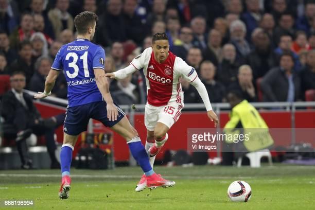 Matija Nastasic of FC Schalke 04 Justin Kluivert of Ajaxduring the UEFA Europa League quarter final match between Ajax Amsterdam and FC Schalke 04 at...