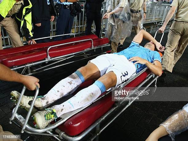 Matija Nastasic of Mancester City is taken from the ground with an injury during the Barclays Asia Trophy Final match between Manchester City and...