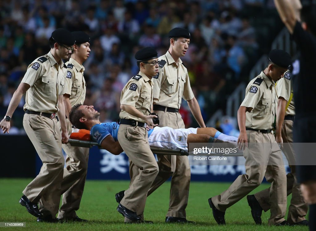 Matija Nastasic of Mancester City is taken from the ground with an injury during the Barclays Asia Trophy Final match between Manchester City and Sunderland at Hong Kong Stadium on July 27, 2013 in So Kon Po, Hong Kong.