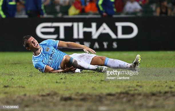 Matija Nastasic of Mancester City suffers an injury during the Barclays Asia Trophy Final match between Manchester City and Sunderland at Hong Kong...